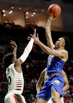 Pittsburgh guard Trey McGowens (2) shoots as Miami guard Chris Lykes (0) defends during the first half of an NCAA college basketball game, Sunday, Jan. 12, 2020, in Coral Gables, Fla. (AP Photo/Lynne Sladky)