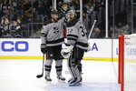 Los Angeles Kings defenseman Alec Martinez, left, congratulates goaltender Jonathan Quick after the Kings defeated the Calgary Flames 4-1 in an NHL hockey game in Los Angeles, Saturday, Oct. 19, 2019. (AP Photo/Alex Gallardo)