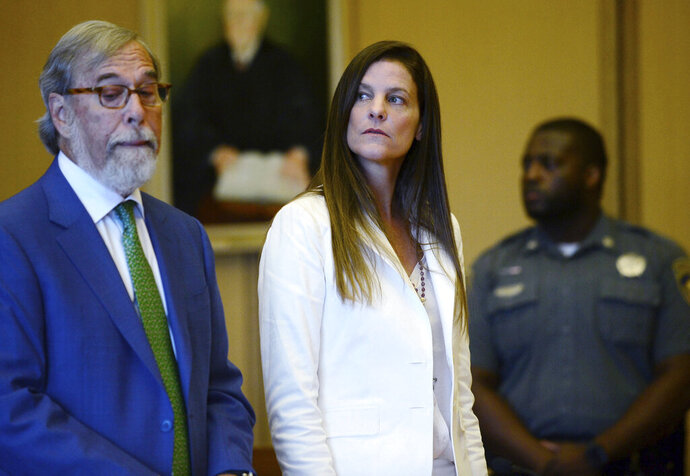 Michelle Troconis and her legal team including Andrew Bowman, left, arrange their next court date in her appearance for tampering with evidence and hindering the investigation into the disappearance of Jennifer Dulos at Stamford Superior Court Thursday, July 18, 2019 in Stamford, Conn.   Troconis, has pleaded not guilty to evidence tampering and hindering prosecution charges in connection with the May 24 disappearance of New Canaan resident Jennifer Dulos. (Erik Trautmann/Hearst Connecticut Media via AP, Pool)