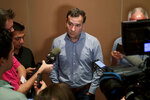 "FILE - This Nov. 12, 2019, file photo shows Chicago White Sox general manager Rick Hahn speaking during a media availability at the Major League Baseball general managers annual meetings in Scottsdale, Ariz. For a number of rebuilding teams, the 2020 baseball season was supposed to be another step in the progression of their top prospects eventually reaching the big leagues. ""It is affecting all 30 clubs,"" Hahn said. ""And it is something that as we head into the fall, winter, the 2021 season we're going to have to adjust our expectations in terms of guys' pacing, in terms of guys' likelihood and timing at making an impact at the next level.""(AP Photo/Matt York, File)"