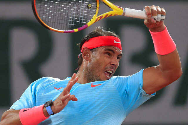 Spain's Rafael Nadal plays a shot against Italy's Stefano Travaglia in the third round match of the French Open tennis tournament at the Roland Garros stadium in Paris, France, Friday, Oct. 2, 2020. (AP Photo/Michel Euler)