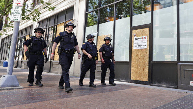 Cleveland police patrol the streets, Monday, June 1, 2020, in downtown Cleveland. The City of Cleveland extended its curfew through Tuesday night after riots broke out on Saturday in reaction to George Floyd's death while in police custody on May 25 in Minneapolis. (AP Photo/Tony Dejak)