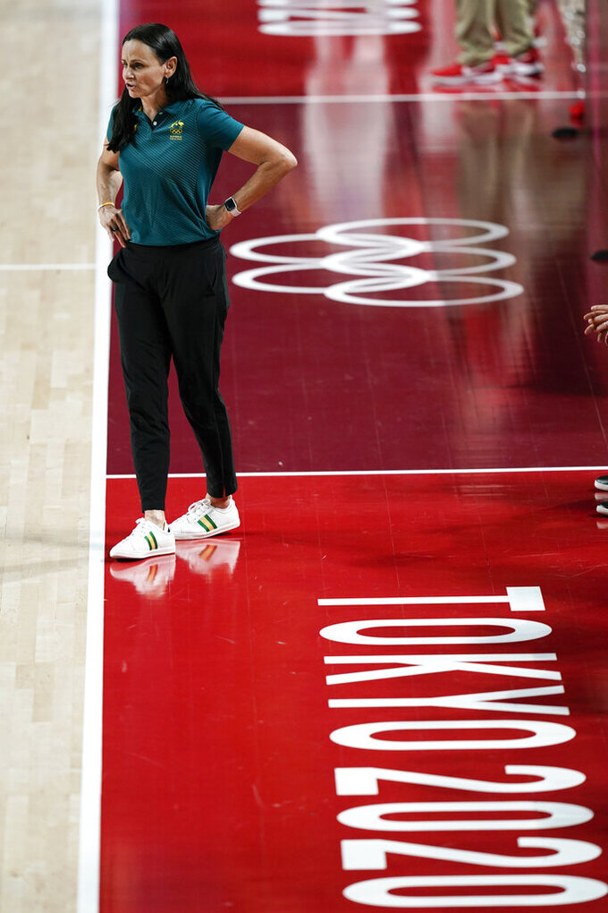 Australia head coach Sandy Brondello watches from the bench during a women's basketball preliminary round game at the 2020 Summer Olympics, Monday, Aug. 2, 2021, in Saitama, Japan. (AP Photo/Charlie Neibergall)