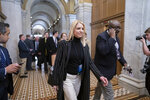 Pam Bondi, a White House adviser and member of the legal team, departs the Senate following opening arguments by the Republicans in the impeachment trial of President Donald Trump on charges of abuse of power and obstruction of Congress, at the Capitol in Washington, Saturday, Jan. 25, 2020. (AP Photo/J. Scott Applewhite)
