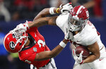 FILE - In this Dec. 1, 2018, file photo, Alabama tight end Irv Smith Jr. (82), right, hits Georgia defensive back Tyson Campbell (3) in the helmet during the first half of the Southeastern Conference championship NCAA college football game, in Atlanta. Smith is a possible pick in the 2019 NFL Draft.(AP Photo/John Bazemore, File)