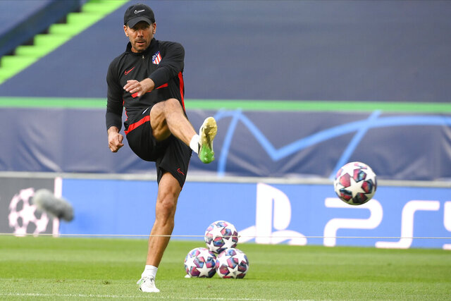 Atletico Madrid's head coach Diego Simone kicks a ball during a training session at the Jose Alvalade stadium in Lisbon, Wednesday Aug. 12, 2020. Atletico Madrid will play Leipzig in a Champions League quarterfinals soccer match on Thursday. (Lluis Gene/Pool via AP)