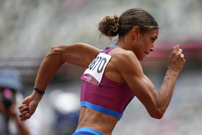 Sydney McLaughlin, of the United States, wins the women's 400-meter hurdles final at the 2020 Summer Olympics, Wednesday, Aug. 4, 2021, in Tokyo, Japan. (AP Photo/Petr David Josek)
