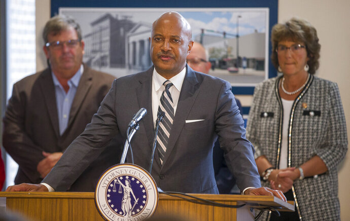 FILE - In this Oct. 3, 2019 file photo Indiana Attorney General Curtis Hill holds a news conference in South Bend, Ind., to speak about recently found fetal remains in former abortion doctor Ulrich Klopfer's home. Hill said Friday, Oct. 11, 2019, that 165 sets of fetal remains have been found in the Chicago area inside a car owned by the late Indiana abortion doctor, boosting the total number of abandoned sets of fetal remains discovered at properties linked to him to more 2,400. (Robert Franklin/South Bend Tribune via AP)