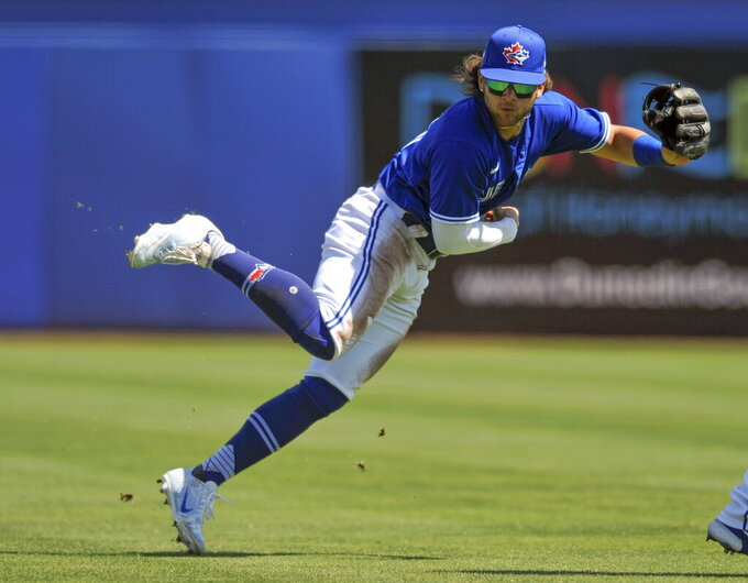 Toronto Blue Jays shortstop Bo Bichette makes a play on a ground ball hit by New York Yankees' Tyler Wade during the fifth inning of a spring training baseball game Sunday, March 14, 2021, at TD Ballpark in Dunedin, Fla. (Steve Nesius/The Canadian Press via AP)
