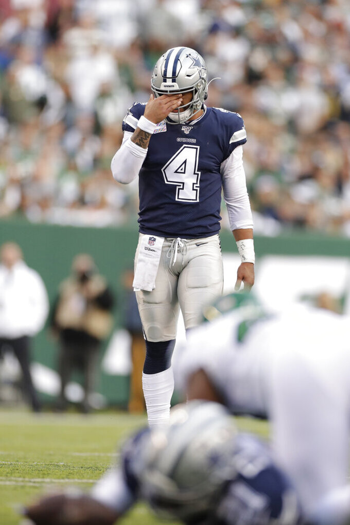 Dallas Cowboys' Dak Prescott reacts during the first half of an NFL football game against the New York Jets, Sunday, Oct. 13, 2019, in East Rutherford, N.J. (AP Photo/Adam Hunger)