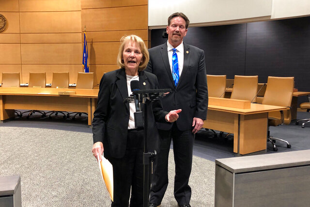 state Sen. Mary Kiffmeyer, R-Big Lake, and Sen. Mark Koran, R-North Branch, appear at a news conference, Tuesday, Feb. 18, 2020, at the Minnesota Senate Building in St. Paul, Minn. They appeared in support of Kiffmeyer's bill to tie legislative authorization for the secretary of state to spend a new round of federal election security money to passing her proposal for a provisional balloting system that Democrats warn could suppress turnout. (AP Photo/Steve Karnowski)