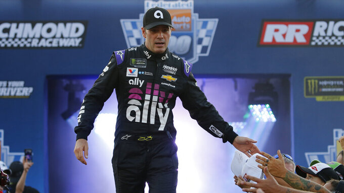 Jimmie Johnson greets fans during driver introductions for the NASCAR Monster Energy Cup series auto race at Richmond Raceway in Richmond, Va., Saturday, Sept. 21, 2019. (AP Photo/Steve Helber)