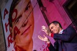 Spain's Prime Minister and Socialist Party leader Pedro Sanchez applauds outside the party headquarters following the general election in Madrid, Spain, Sunday, Nov.10, 2019. Spain's Interior Ministry says that early results show Socialists winning Spain's national election, but without a clear end to the country's political deadlock. (AP Photo/Bernat Armangue)