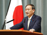 Japan's Chief Cabinet Secretary Yoshihide Suga speaks during a press conference in Tokyo, Tuesday Oct. 23, 2018. Japan's government said Tuesday that a man believed to be a Japanese freelance journalist who went missing three years ago while in Syria has been released and is now in Turkey. Suga told a hastily arranged news conference late Tuesday that Japan was informed by Qatar that the man, believed to be journalist Jumpei Yasuda, has been released. (Kyodo News via AP)