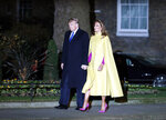 U.S. President Donald Trump and first lady Melania arrive at 10 Downing Street in London ahead of a NATO reception hosted by British Prime Minister Boris Johnson, Tuesday, Dec. 3, 2019. U.S. President Donald Trump and his NATO counterparts were gathering in London Tuesday to mark the alliance's 70th birthday amid deep tensions as spats between leaders expose a lack of unity that risks undermining military organization's credibility. (AP Photo/Alastair Grant, Pool)
