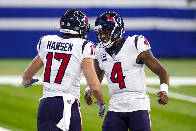 Houston Texans wide receiver Chad Hansen (17) celebrates a touchdown with quarterback Deshaun Watson (4) n the first half of an NFL football game against the Indianapolis Colts in Indianapolis, Sunday, Dec. 20, 2020. (AP Photo/Darron Cummings)