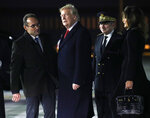 President Donald Trump and first lady Melania Trump are greeted after arriving on Air Force One at Orly airport near Paris, Friday, Nov. 9, 2018. Trump is joining other world leaders at centennial commemorations in Paris this weekend to mark the end of World War I. (AP Photo/Jacquelyn Martin)