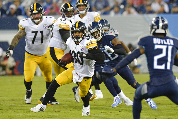 Pittsburgh Steelers running back James Conner (30) runs the ball against the Tennessee Titans in the first half of a preseason NFL football game Sunday, Aug. 25, 2019, in Nashville, Tenn. (AP Photo/Mark Zaleski)