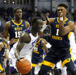 TCU forward Lat Mayen (11) works against West Virginia forward Lamont West (15) and forward Derek Culver (1) for a shot opportunity in the second half of an NCAA college basketball game, Tuesday, Jan. 15, 2019, in Fort Worth, Texas. (AP Photo/Tony Gutierrez)