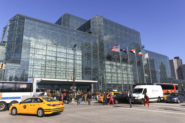 "FILE - This Oct. 6, 2016, file photo shows an exterior of the Javits Center during the first day of New York Comic Con. New York City lawmakers are poised to adopt legislation requiring ""bird-friendly"" glass on all new construction to cut down on the tens of thousands of birds who die flying into the city's buildings every year. (AP Photo/Steve Luciano, File)"