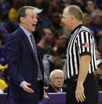 Northwestern head coach Chris Collins, left, speaks with an official during the second half of an NCAA college basketball game against Iowa, Wednesday, Jan. 9, 2019, in Evanston, Ill. Iowa won 73-63. (AP Photo/Nam Y. Huh)