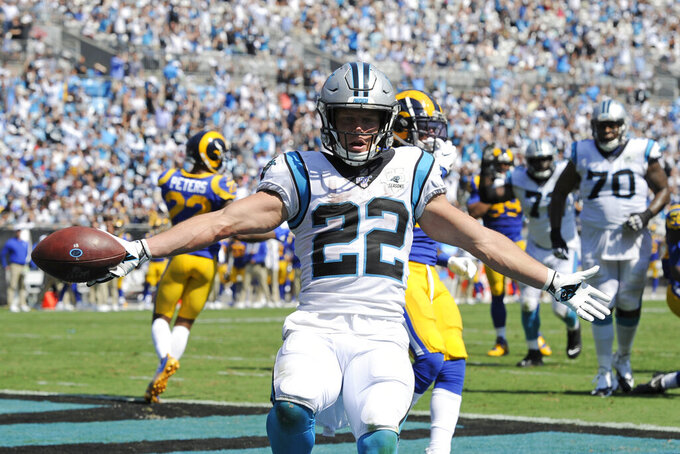 Carolina Panthers running back Christian McCaffrey (22) reacts following a touchdown against the Los Angeles Rams during the second half of an NFL football game in Charlotte, N.C., Sunday, Sept. 8, 2019. (AP Photo/Mike McCarn)
