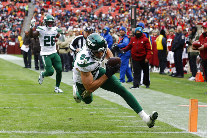 New York Jets tight end Ryan Griffin (84) runs towards the end zone for a touchdown against the Washington Redskins during the first half of an NFL football game, Sunday, Nov. 17, 2019, in Landover, Md. (AP Photo/Patrick Semansky)