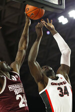 Mississippi State forward Abdul Ado (24) blocks a shot from Georgia forward Derek Ogbeide (34) during an NCAA college basketball game in Athens, Ga., Wednesday, Feb. 20, 2019. (Joshua L. Jones/Athens Banner-Herald via AP)