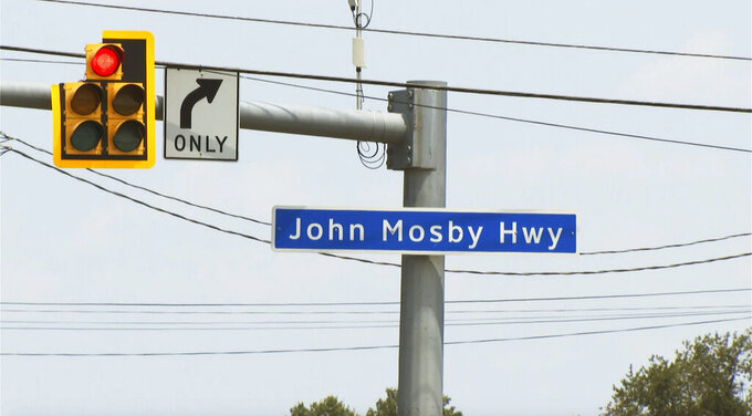 This Monday July 26, 2021 photo shows a sign for the  John Mosby Highway in Loudoun County, Va.  The names of Confederate leaders are being stripped from schools and major highways throughout Virginia. But when it comes to the many side streets in the state that carry Confederate names, it's a different story. (AP Photo/Dan Huff)
