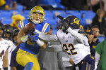 California cornerback Traveon Beck, right, breaks up a pass intended for UCLA wide receiver Kyle Philips during the second half of an NCAA college football game Saturday, Nov. 30, 2019, in Pasadena, Calif. California won 28-18. (AP Photo/Mark J. Terrill)
