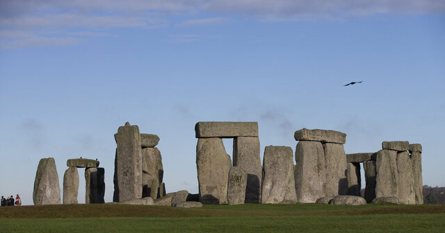 "FILE - In this Tuesday, Dec. 17, 2013 file photo, visitors take photographs of the world heritage site of Stonehenge, in Wiltshire England. The prehistoric monument of Stonehenge in southern England was closed to visitors Saturday, Dec. 5, 2020, in the afternoon after protesters staged a ""mass trespass"" against the British government's road-building plans, which includes a new tunnel near the World Heritage Site. The protesters, who described themselves as an alliance of local residents, ecologists, activists, archaeologists and pagans, gathered at Stonehenge around midday.  (AP Photo/Alastair Grant, File)"