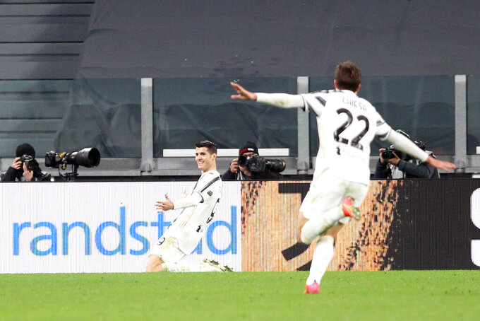 Juventus' Alvaro Morata, left, celebrates scoring a goal, 2-1, during a Serie A soccer match between Juventus and Lazio, in Turin's Allianz Stadium, Italy, Saturday, March 6, 2021. (Tano Pecoraro/LaPresse via AP)