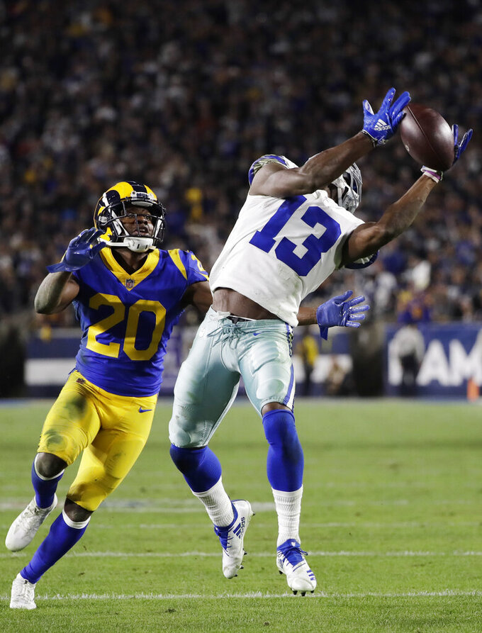 Dallas Cowboys wide receiver Michael Gallup catches a pass over Los Angeles Rams free safety Lamarcus Joyner during the second half in an NFL divisional football playoff game Saturday, Jan. 12, 2019, in Los Angeles. (AP Photo/Marcio Jose Sanchez)