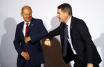 The President of the Eurogroup, Paschal Donohoe, right, is welcomed by Federal Finance Minister Olaf Scholz, left, for the Informal Meeting of Economics and Finance Ministers in Berlin, Germany, Friday, Sept. 11, 2020. (Hannibal Hanschke/Pool Photo via AP)