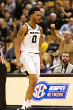 Missouri's Torrence Watson celebrates before a timeout during the second half of an NCAA college basketball game against Mississippi Tuesday, Feb. 18, 2020, in Columbia, Mo. Missouri won 71-68.(AP Photo/L.G. Patterson)