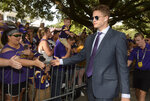 LSU quarterback Joe Burrow greets fans as he and the team walk down the hill to Tiger Stadium before an NCAA college football game against Northwestern State, Saturday, Sept. 14, 2019, in Baton Rouge, La. (AP Photo/Patrick Dennis)