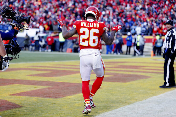 Kansas City Chiefs' Damien Williams celebrates his touchdown run during the second half of the NFL AFC Championship football game against the Tennessee Titans Sunday, Jan. 19, 2020, in Kansas City, MO. (AP Photo/Charlie Neibergall)