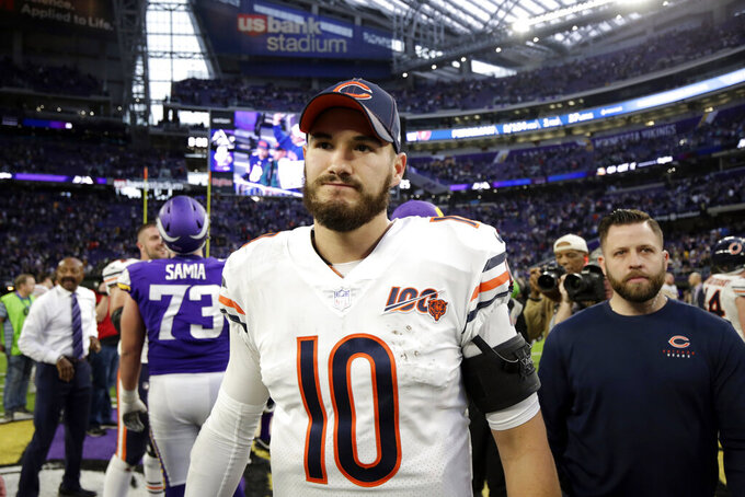 FILE - In this Dec. 29, 2019, file photo, Chicago Bears quarterback Mitchell Trubisky walks off the field after an NFL football game against the Minnesota Vikings in Minneapolis. Th Bears have declined their fifth-year option for Trubisky for the 2021 season, a person familiar with the situation said Saturday, May 2, 2020. The move is hardly a surprise considering the way Trubisky struggled in his third season since the Bears drafted him with the No. 2 overall pick. (AP Photo/Andy Clayton-King, File)