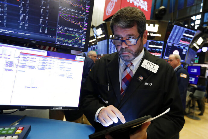 FILE - In this Dec. 5, 2019, file photo trader James MacGilvray works on the floor of the New York Stock Exchange. The U.S. stock market opens at 9:30 a.m. EST on Monday, Dec. 30. (AP Photo/Richard Drew, File)