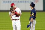 St. Louis Cardinals first baseman Paul Goldschmidt (46) laughs as he talks with Milwaukee Brewers' Christian Yelich during a pause in the action in the fifth inning of a baseball game Thursday, Sept. 24, 2020, in St. Louis. (AP Photo/Jeff Roberson)