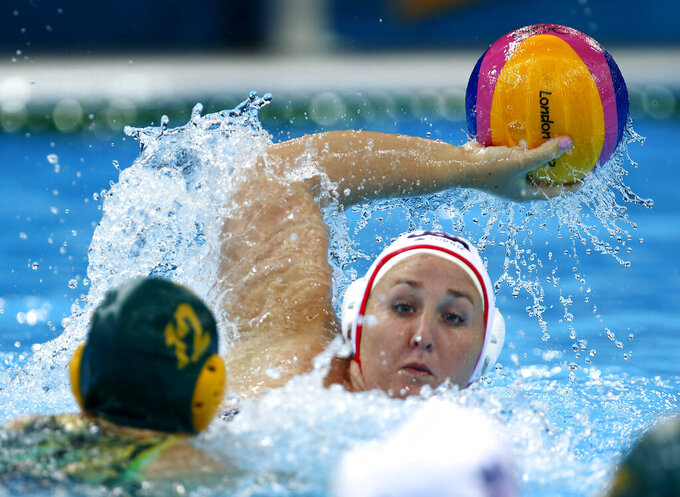 FILE - In this Aug. 7, 2012, file photo, Melissa Seidemann, right, of the United States looks to pass against Nicola Zagame of Australia during a women's semifinal water polo match at the 2012 Summer Olympics in London. The U.S. women's water polo team got a big lift when Seidemann decided to go for a third straight gold medal at the Tokyo Olympics. (AP Photo/Julio Cortez, File)