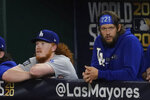 Los Angeles Dodgers starting pitcher Dustin May and starting pitcher Clayton Kershaw watch during the ninth inning in Game 5 of the baseball World Series against the Tampa Bay RaysSunday, Oct. 25, 2020, in Arlington, Texas. (AP Photo/Tony Gutierrez)