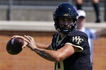 Wake Forest quarterback Sam Hartman passes against the Norfolk State during the first half of a NCAA college football game Saturday, Sept. 11, 2021, in Winston-Salem, N.C. (AP Photo/Chris Carlson)
