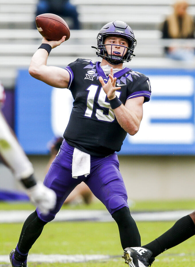 TCU quarterback Max Duggan (15) throws during the second half of an NCAA college football game against Oklahoma, Saturday, Oct. 24, 2020, in Fort Worth, Texas.  (AP Photo/Brandon Wade)