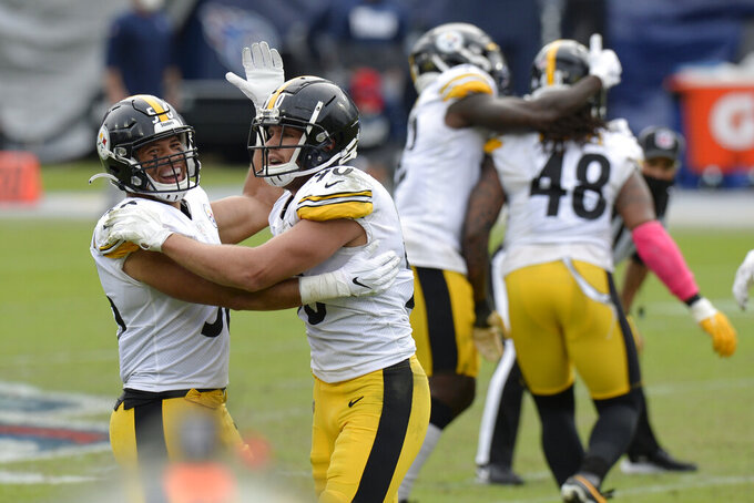 Pittsburgh Steelers linebackers Alex Highsmith (56) and T.J. Watt (90) celebrate after a 45-yard field goal attempt by Tennessee Titans kicker Stephen Gostkowski was no good in the final seconds of the fourth quarter in an NFL football game Sunday, Oct. 25, 2020, in Nashville, Tenn. The Steelers won 27-24. (AP Photo/Mark Zaleski)