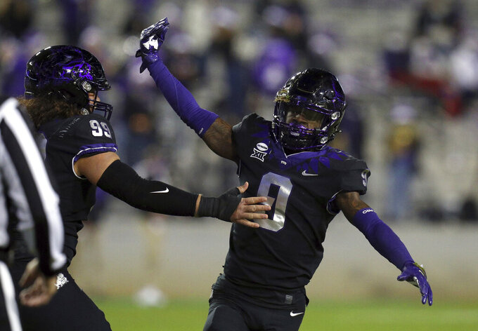 TCU cornerback C.J. Ceasar II (9) gets a pat from defensive tackle Soni Misi (99) after an interception against Louisiana Tech in the third quarter during an NCAA college football game, Saturday, Dec. 12, 2020. (AP Photo/ Richard W. Rodriguez)