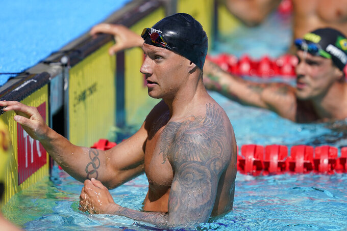 Caeleb Dressel looks at the results after competing in the men's 50-meter freestyle final at the TYR Pro Swim Series swim meet Saturday, April 10, 2021, in Mission Viejo, Calif. Dressel finished second. (AP Photo/Ashley Landis)
