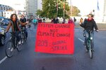 Protesters hold a banner during a bicycle parade in Berlin, Germany, Friday, Sept. 20, 2019 as part of the 'Friday For Future' global strike. Similar rallies are planned Friday in cities around the globe. In the United States more than 800 events were planned Friday, while in Germany more than 400 rallies are expected. (Kay Nietfeld/dpa via AP)