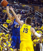 Creighton center Kelvin Jones (43) is blocked by Michigan center Jon Teske (15) during the first half of an NCAA college basketball game at Crisler Center in Ann Arbor, Mich., Tuesday, Nov. 12, 2019. (AP Photo/Tony Ding)