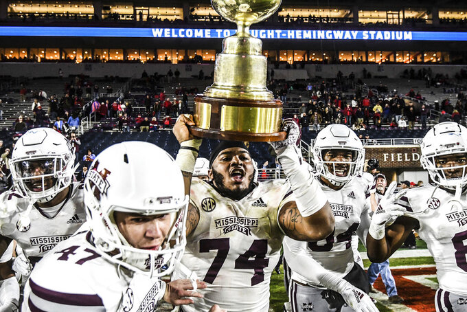 Mississippi State offensive lineman Elgton Jenkins (74) holds the Golden Egg following the team's win over Mississippi in an NCAA college football game Thursday, Nov. 22, 2018, in Oxford, Miss. Mississippi State won 35-3. (Bruce Newman/The Oxford Eagle via AP)